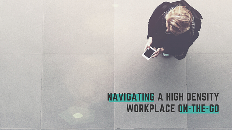 Employee uses a workplace app to navigate inside a high-density office building